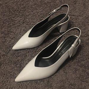 White pointy toed sling backs